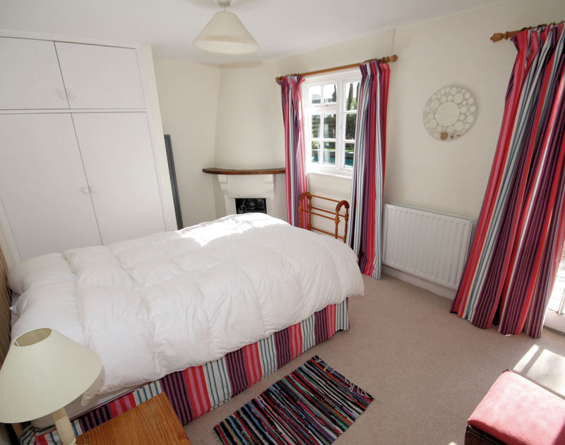 The ground floor double bedroom of Trewiston Cottage, a traditional holiday house at Daymer Bay, Cornwall