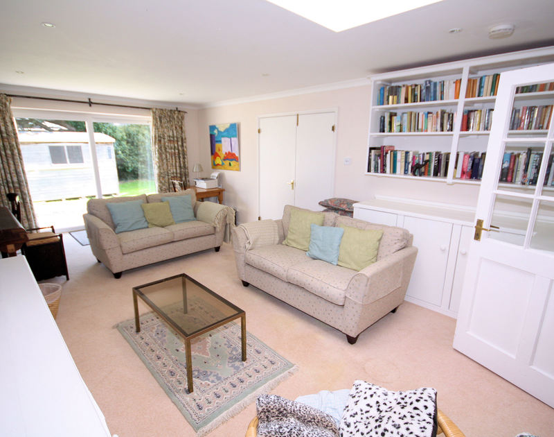 The comfy TV room of Trewiston Cottage, a charming holiday house at Daymer Bay, Cornwall