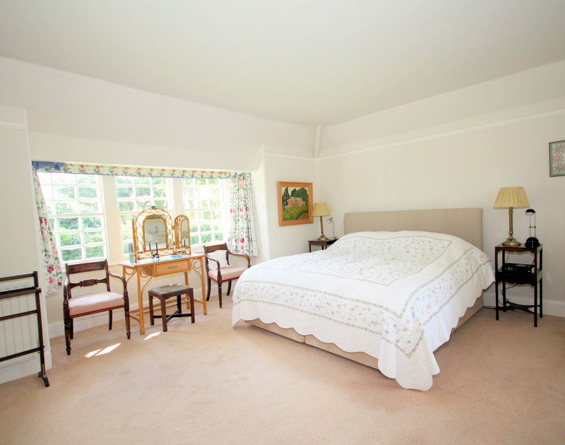 The spacious double bedroom of Trewiston Cottage, a traditional holiday house at Daymer Bay, with superking size bed.