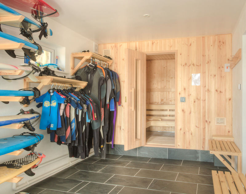 The sauna and the useful wet room with board and wetsuit storage at Treverden, a self catering holiday house to rent on the coast at New Polzeath, Cornwall.
