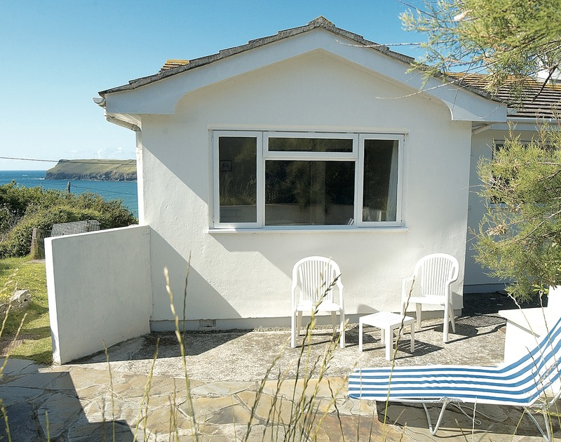 Sunny, sheltered patio at Trevega, a holiday house to rent in Polzeath, Cornwall