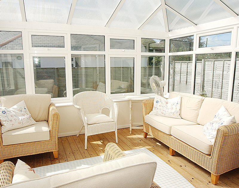 The sunny conservatory at Trevian a self catering holiday house to rent in Rock, North Cornwall.