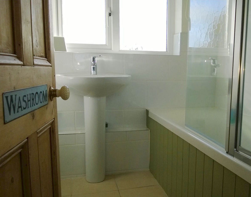 One of two attractive and modern bathrooms in Trevian, a self catering holiday house to rent in Rock, Cornwall.