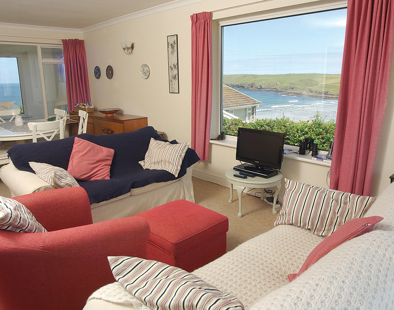 The comfortable sitting room and fantastic sea views at  Trewint, a self catering coastal holiday house in Polzeath, Cornwall.