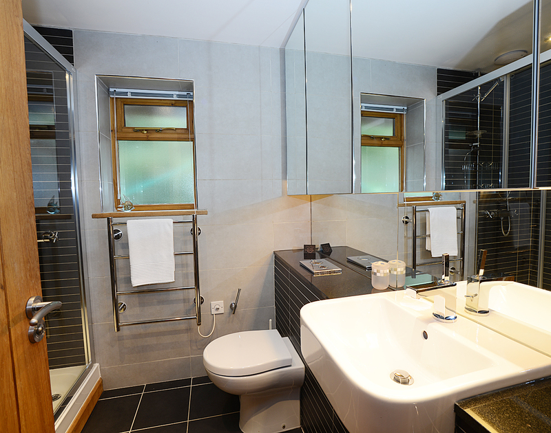 The modern,smart shower room at 7,Sandy Hills a self catering contemporary holiday house in Rock, Cornwall.