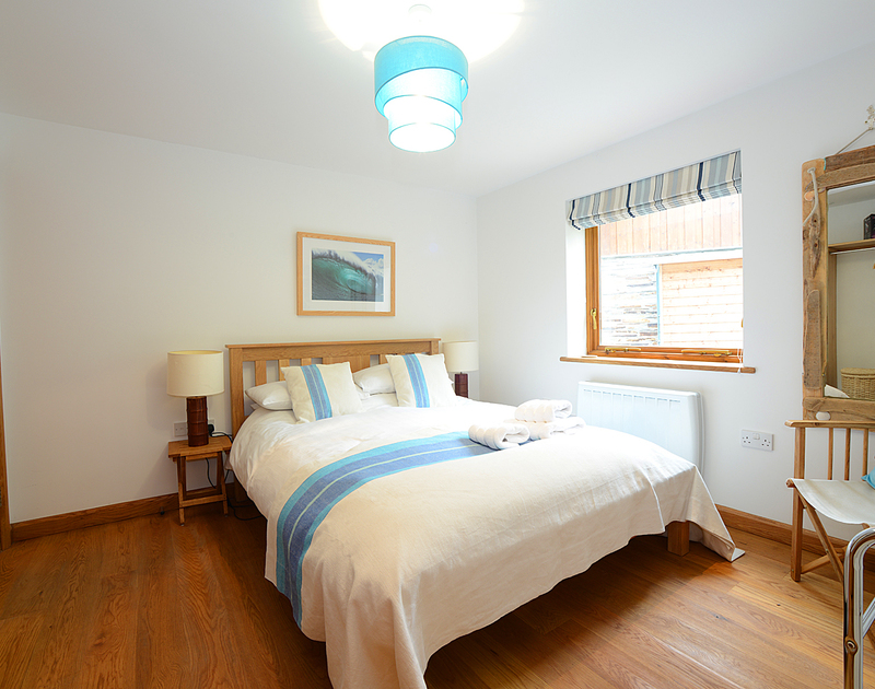 One of the two king size bedrooms in 7, Sandy Hills, a smart,modern family holiday house in Rock in North Cornwall.