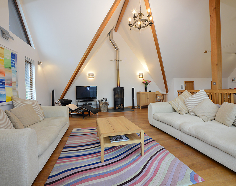 The large vaulted sitting room with attractive,modern wood burner in 7 Sandy Hills, Rock,North Cornwall.