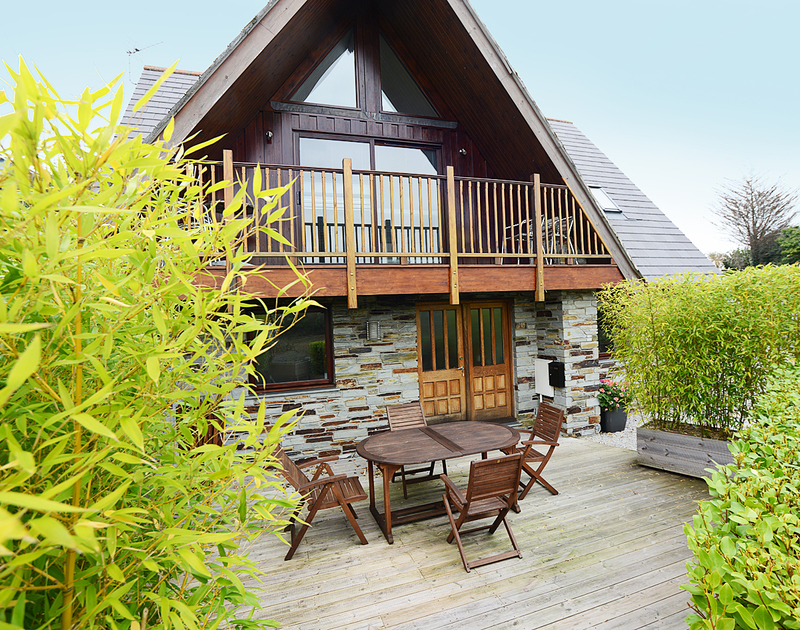 The exterior, balcony and decked terrace of 7,Sandy Hills, a beautifully appointed holiday house to rent in a tucked away position in Rock, Cornwall.