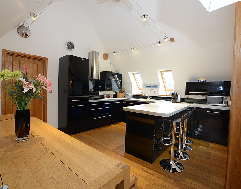The sleek, contemporary kitchen in this luxury holiday rental tucked away in Rock in North Cornwall.