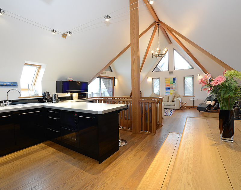 The vast vaulted,light-filled kitchen/dining/living room of 7, Sandy Hills, a luxurious holiday rental in Rock, Cornwall
