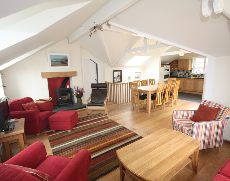 The open plan kitchen/dining room/lounge in Sea Cottage, a self catering holiday cottage, only moments from the beach in Rock, Cornwall.