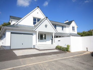 The exterior and the entrance to Cherrytrees, a large family, self catering, pet friendly holiday house to rent in Rock, North Cornwall.