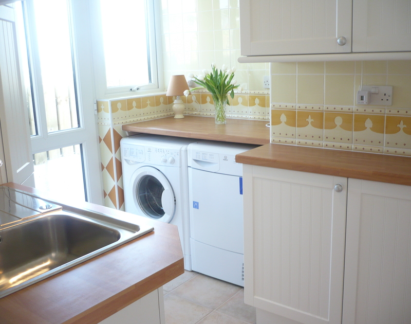 Useful utility room on the ground floor of Polmorla, holiday let in Polzeath