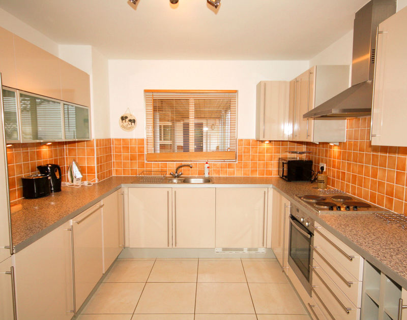 The well equipped kitchen at 3 pentire rocks a holiday house to rent