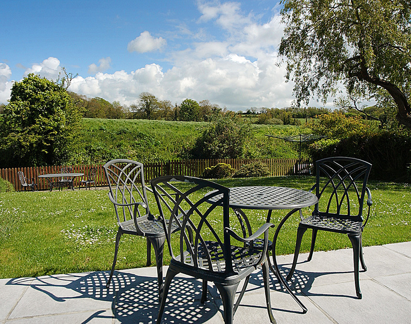 Lovely views over the garden and countryside from the patio at Willowbrook, a holiday rental at Rock, Cornwall