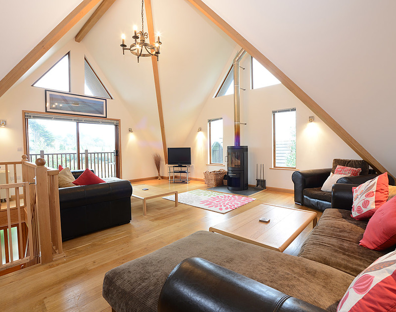The light, spacious sitting room of 8 Sandy Hills, holiday let in Rock, with its vaulted ceiling