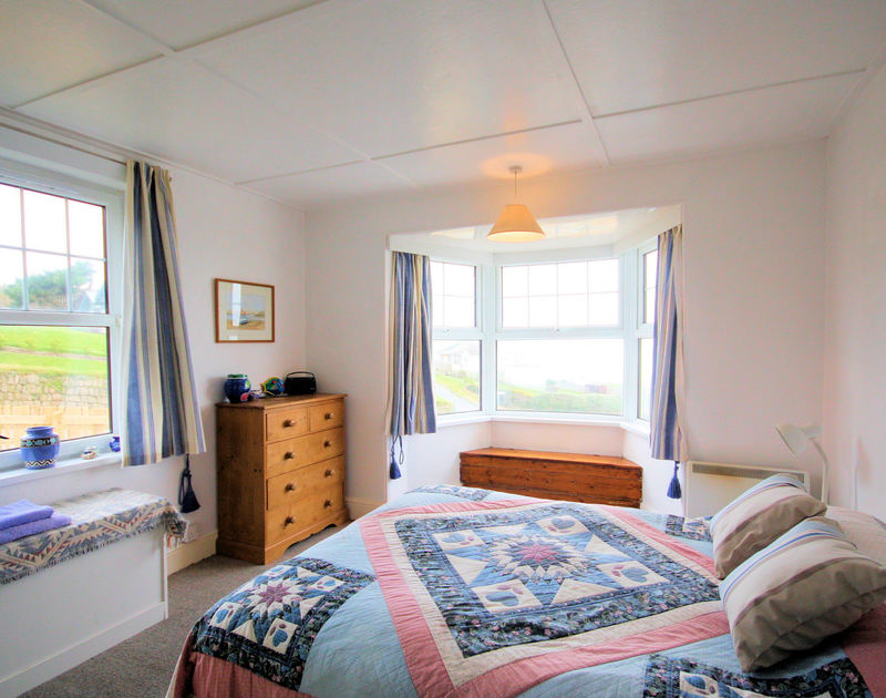 The double bedroom in 5, Pinewood Flat, a self catering holiday rental in Polzeath on the north coast of Cornwall.