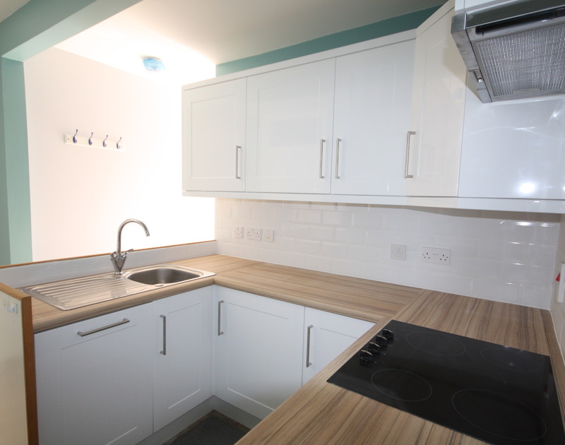 The modern kitchen in 5, Pinewood Flat,a self catering holiday rental in Polzeath, Cornwall.