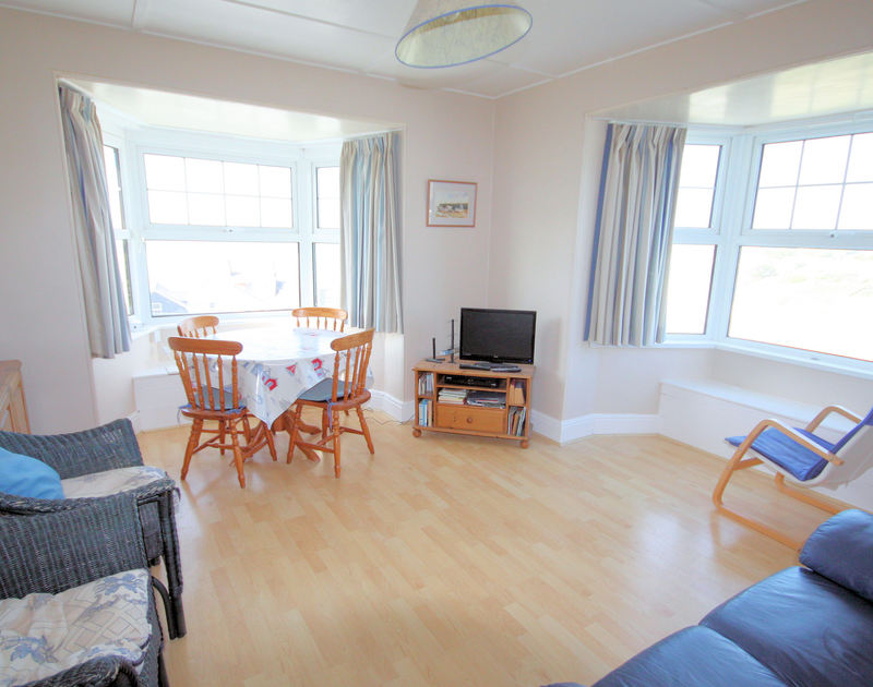 The lounge/diner in 5, Pinewood Flat, a self catering holiday flat to rent in Polzeath, North Cornwall.