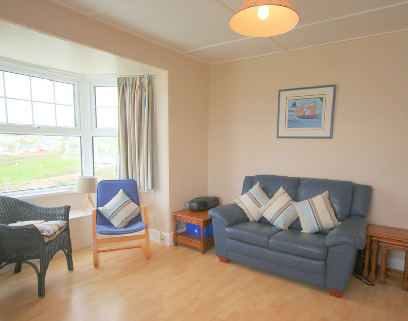 The lounge in 5, Pinewood Flat, a self catering holiday flat to rent on the coast in Polzeath, North Cornwall.