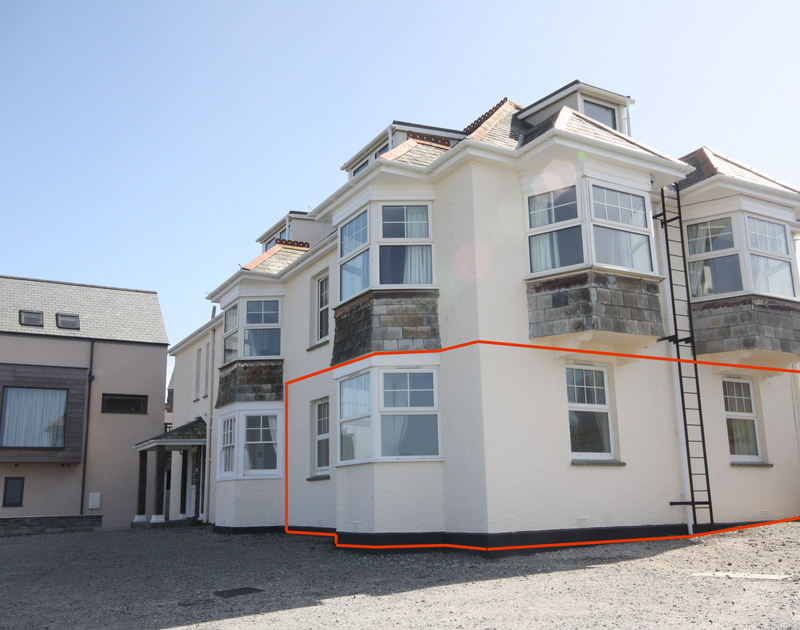 The exterior view of Pinewood Flat 4, a ground-floor self-catering holiday apartment in Polzeath, Cornwall