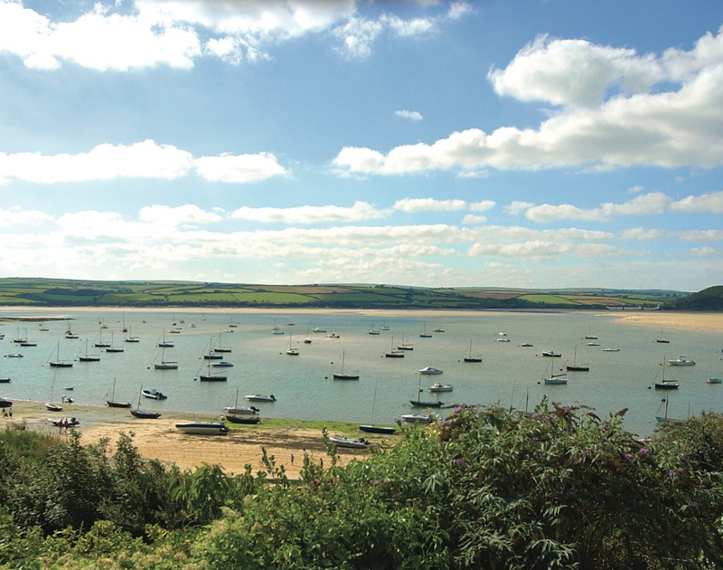 The views of the Camel Estuary and the pretty boat moorings from Carn Du 1, a holiday house to rent in Rock, North Cornwall.