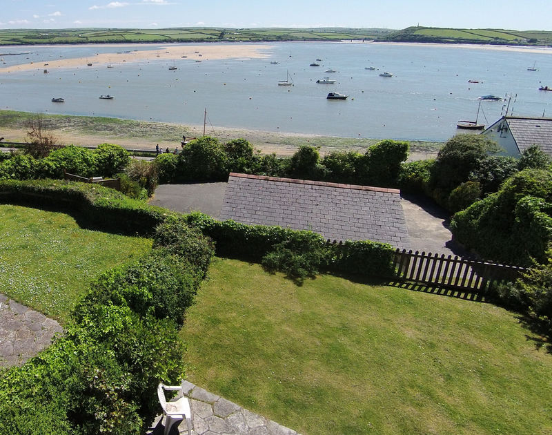 An elevated view of the garden and proximity to the Camel Estuary from Carn Du 1, a self catering holiday house to rent in Rock, Cornwall.