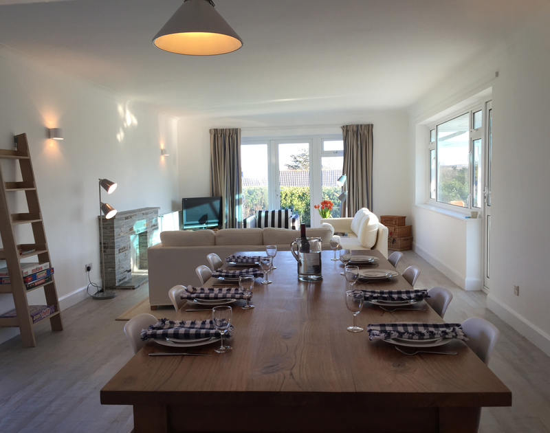 The open plan lounge dining area in Corriana, a self catering holiday rental in  Rock, North Cornwall.