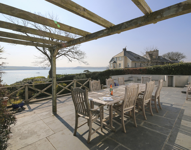 The large, sunny, furnished terrace at Little Strand, a well-positioned holiday house in Rock, Cornwall, with gorgeous sea views.