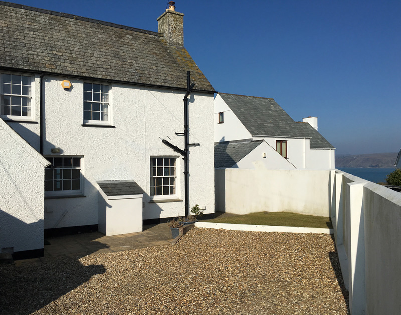 Attractive slate roofed and whitewashed exterior of clifftop holiday property Coastguard Cottage 3, a self catering family seaside holiday home in Port Isaac on the North Coast of Cornwall.