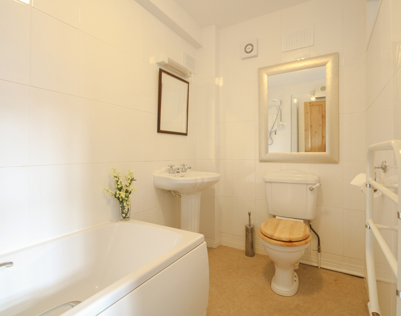 Self catering holiday rental Church Hill Flat's bathroom with shower and heated towel rail in Port Isaac, North Cornwall