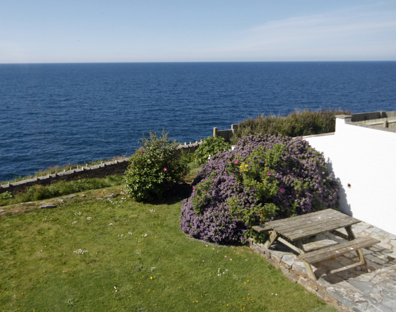 Glorious sea views past the garden and patio from upstairs at 3 Overcliff, a holiday house in Port Isaac, Cornwall,