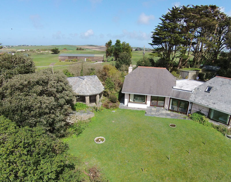 An aerial view of Little Trig, a holiday house to rent in Rock, Cornwall, with St Enodoc Golf Course in the background.