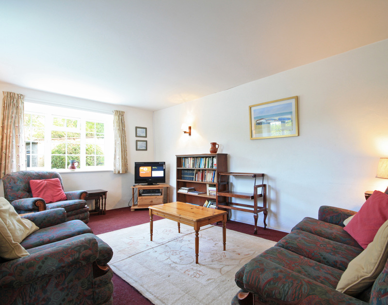 The comfortably furnished sitting room of White House, a holiday cottage near Rock, Cornwall.