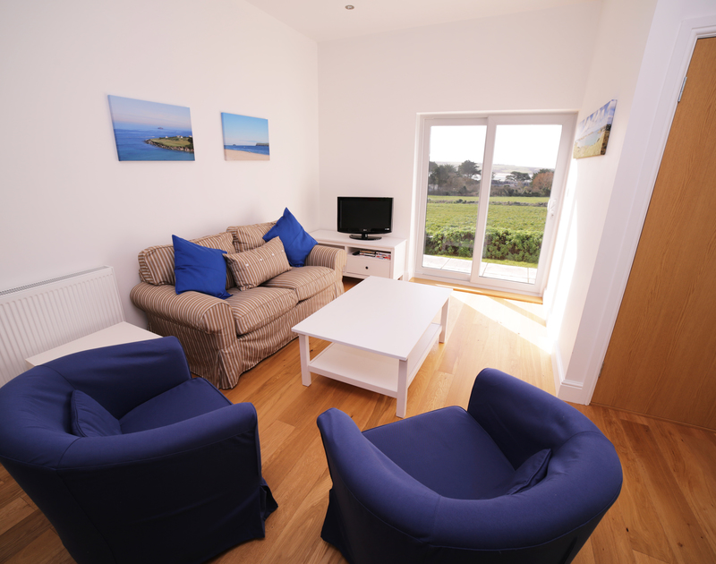 The sitting room at Seaworthy is on the first floor of this holiday property and enjoys lovely views of the Camel Estuary.