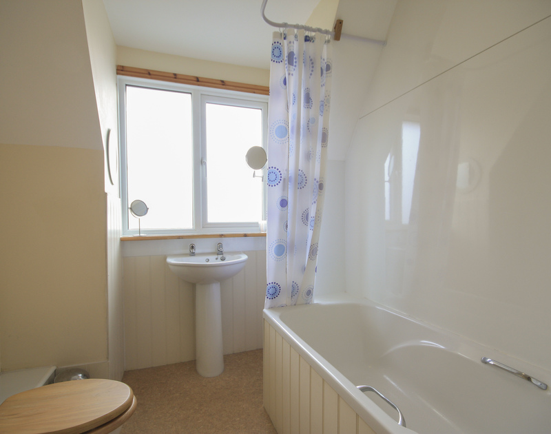 A lovely, light bathroom with a view at Seaworthy, a charming holiday house at Daymer Bay.