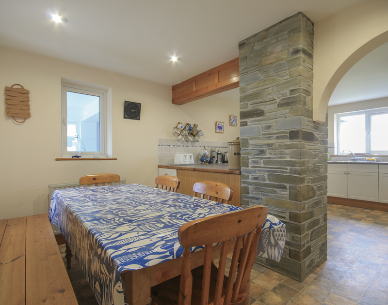 The bright and contemporary dining area of Seaworthy, an attractive cottage at Daymer Bay, North Cornwall.