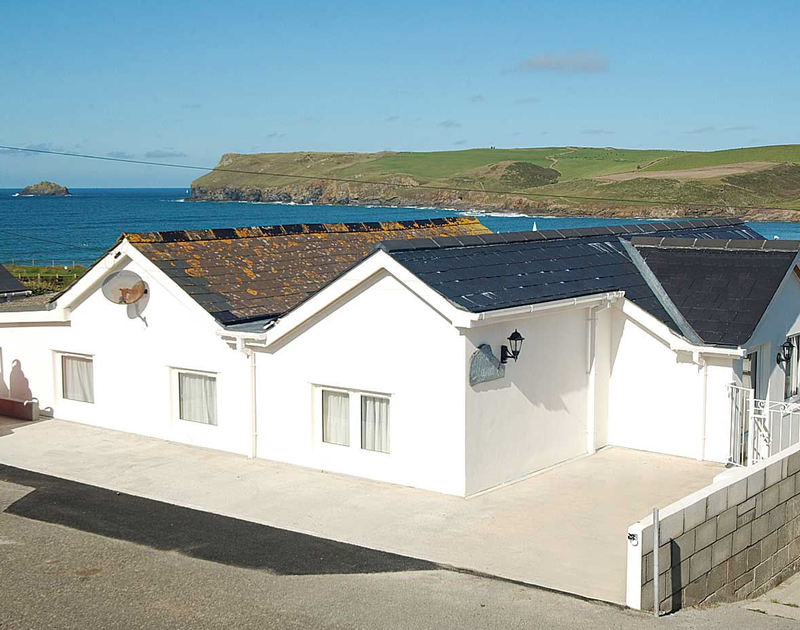 The rear exterior view of Malindi, a holiday house to rent with a great coastal location at Polzeath, Cornwall