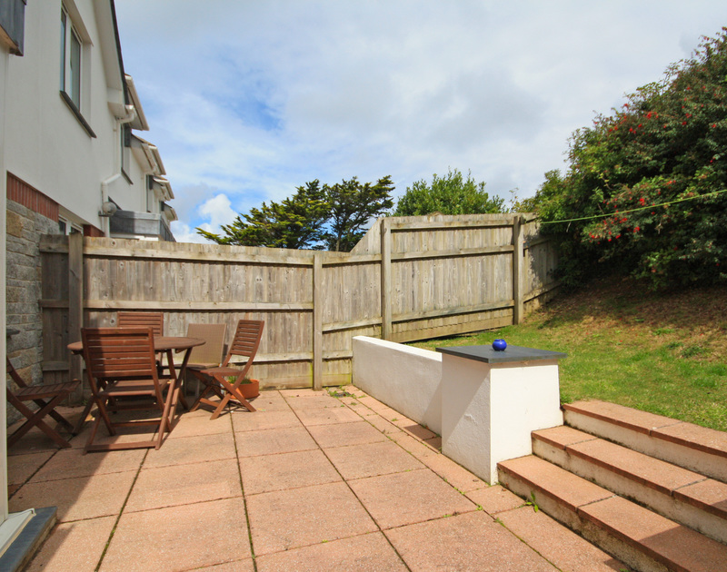 The terrace and small garden at 3,Pentire Rocks, a coastal holiday house to rent in New Polzeath on the North Cornish Coast.