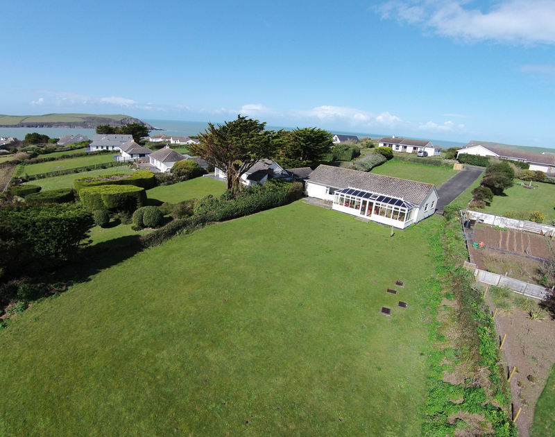 The aerial view of Sandlings, showing the fantastic, coastal position of this self catering holiday house in Daymer Bay Cornwall.