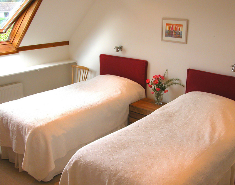An attractive twin bedroom with stylish bedspreads at Rosevallen, a holiday rental at Daymer Bay, Cornwall