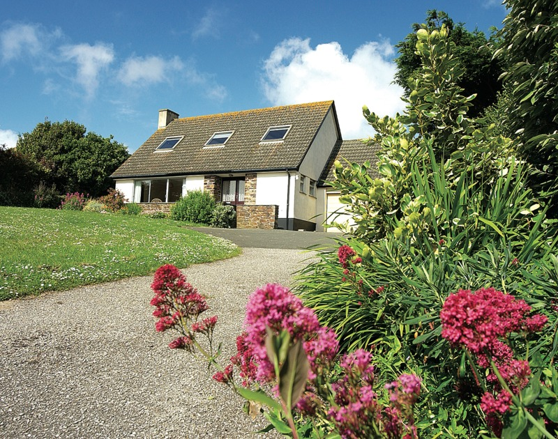 The large driveway and mature gardens of Rosevallen, a self-catering holiday rental at Daymer Bay, Cornwall
