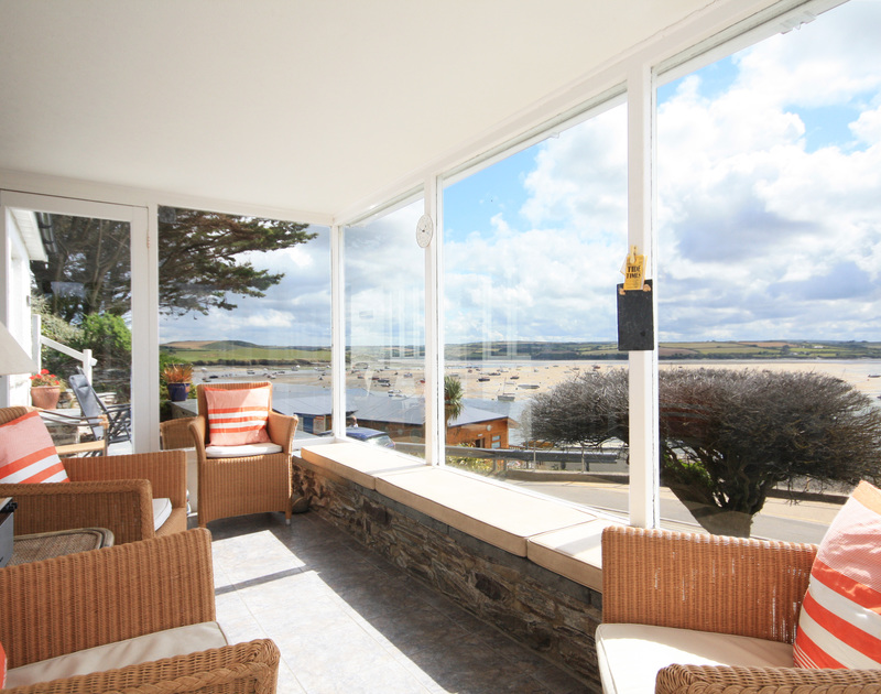 The sunroom of Cocklebar, holiday cottage to rent in Rock, Cornwall, enjoys fabulous views of Padstow across the Camel Estuary.