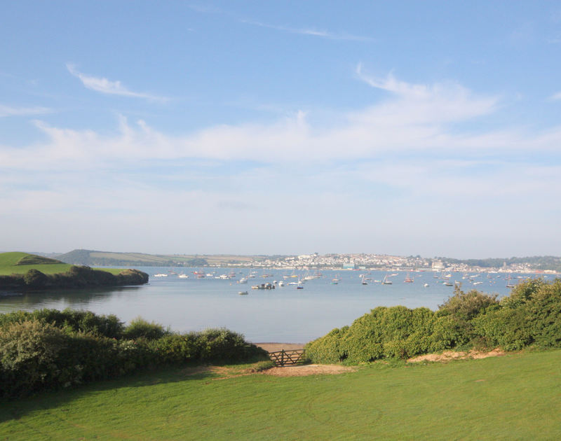 The panoramic views of Padstow and the Camel Estuary from the master bedroom of Harbour Lights, a holiday rental in Rock, Cornwall