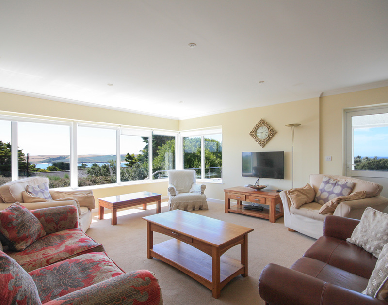 The well furnished sitting room with seaviews at Higher Crawallis, holiday rental at Daymer Bay, Cornwall