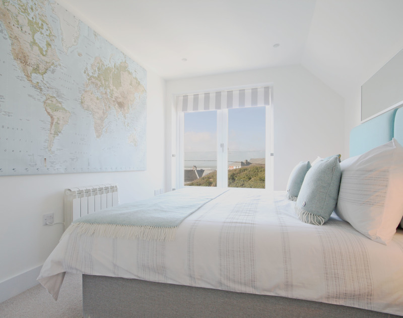 Stylish double bedroom with seaviews at The Beach House, self-catering holiday rental at Polzeath, Cornwall