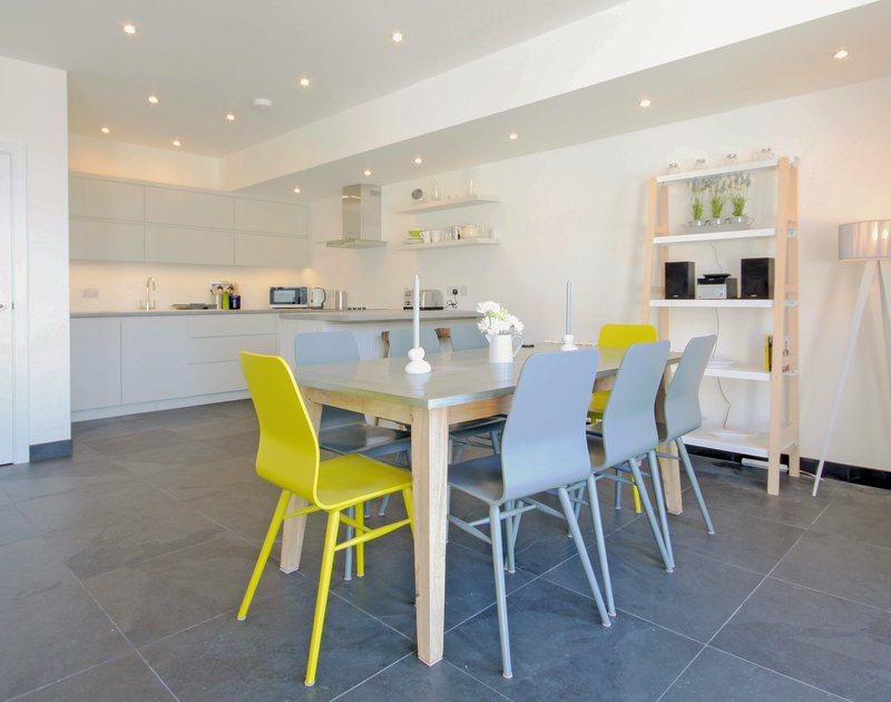 The spacious, stylish kitchen/diner of The Beach House, luxury holiday rental in Polzeath, Cornwall