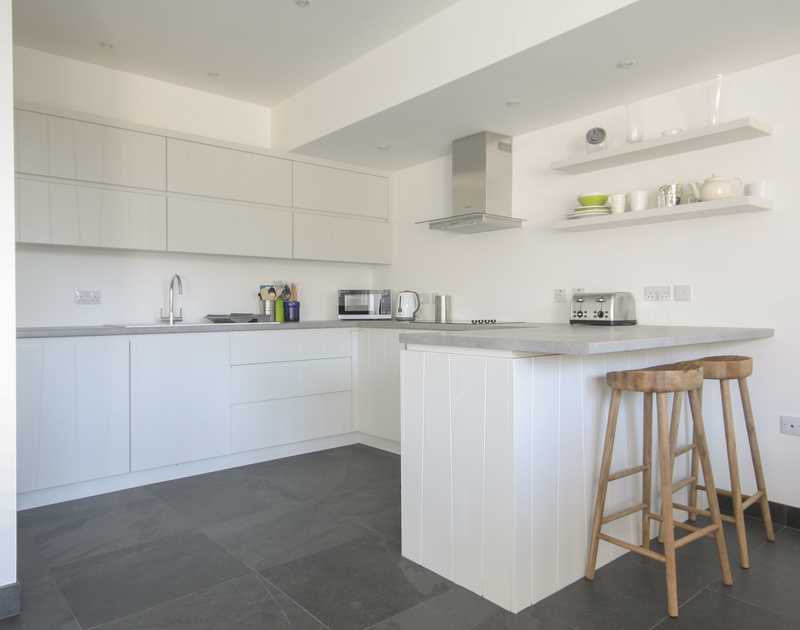 Simple and stylish kitchen and breakfast bar of The Beach House, self-catering holiday let in Polzeath, Cornwall
