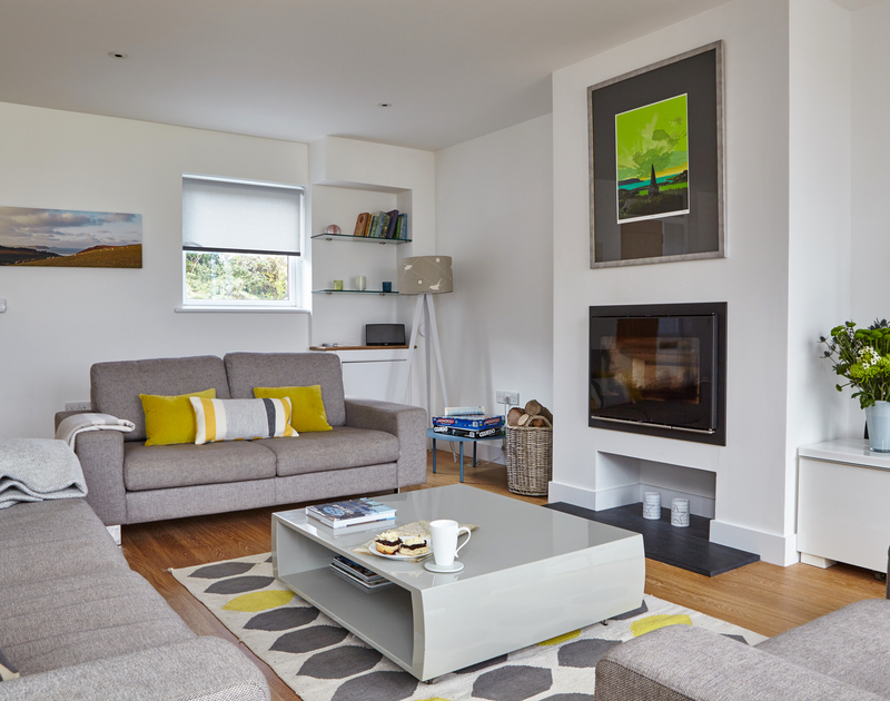 The beautifully furnished sitting area of Epphaven, impressive holiday rental at Polzeath, with its warming woodburner.