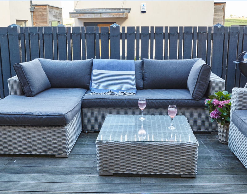 Smart all-weather furniture on the balcony of Epphaven, a stunning holiday let at Polzeath, Cornwall
